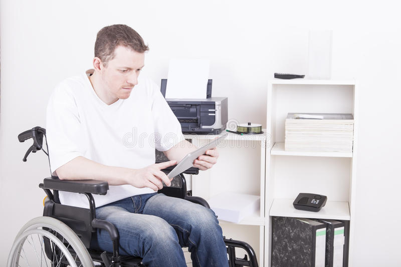 Disabled young man at the office royalty free stock photography
