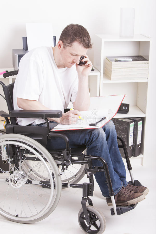Disabled young man at work royalty free stock photos