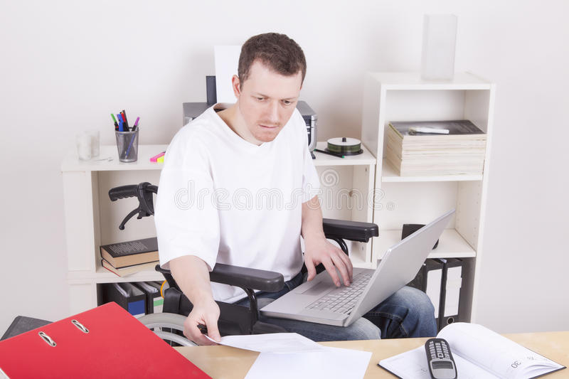 Disabled young man at work royalty free stock photo