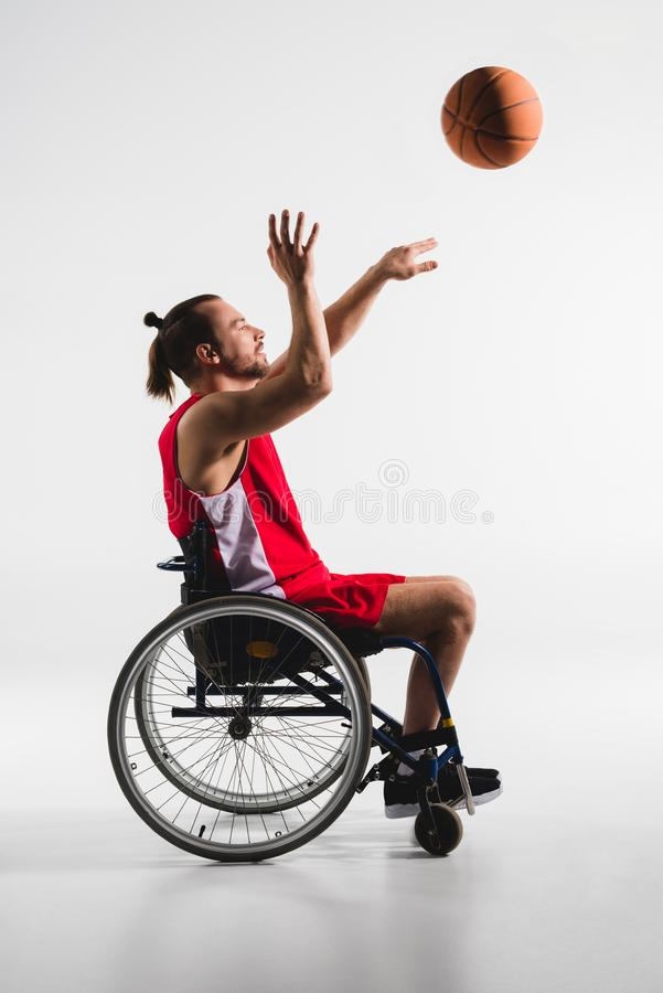 Disabled sportsman throwing basketball stock photography