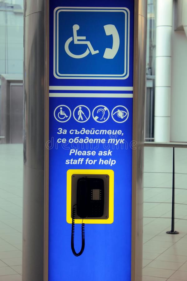 Disadvantaged people. Sofia Airport is one of the few places in Bulgaria, which provides care for people with disabilities. This phone is situated till an royalty free stock image