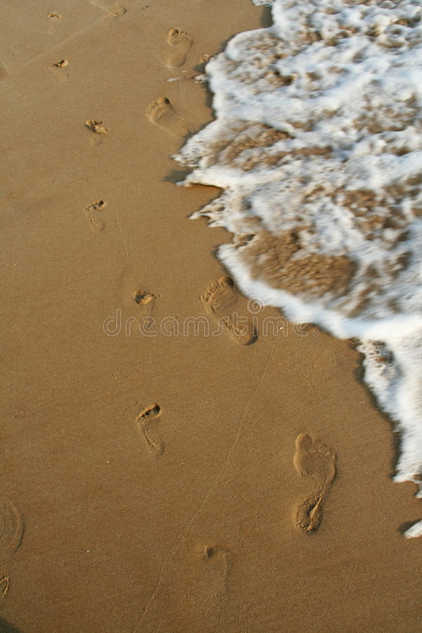 The disappearing of footprints stock photography