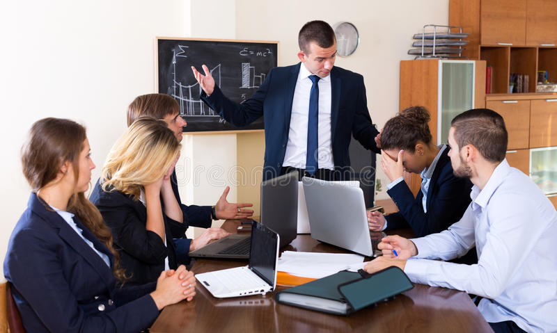 Disappointed boss shouting stock photography