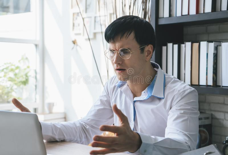 Disappointed man looking at computer screen. Disappointed Business man looking at computer screen royalty free stock photo