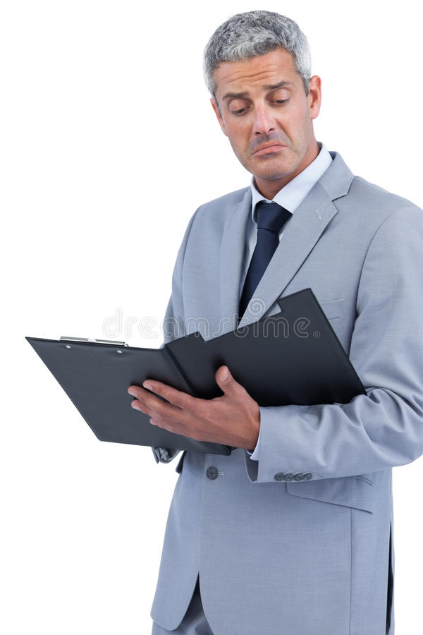 Download Disappointed Businessman Holding Clipboard Stock Photo - Image: 33052386