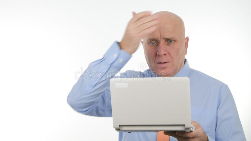 Disappointed Businessman Use Laptop Read Bad Financial News Gesticulate Nervous. Disappointed Businessman Use Laptop Reading Bad Financial News and Gesticulate royalty free stock photos