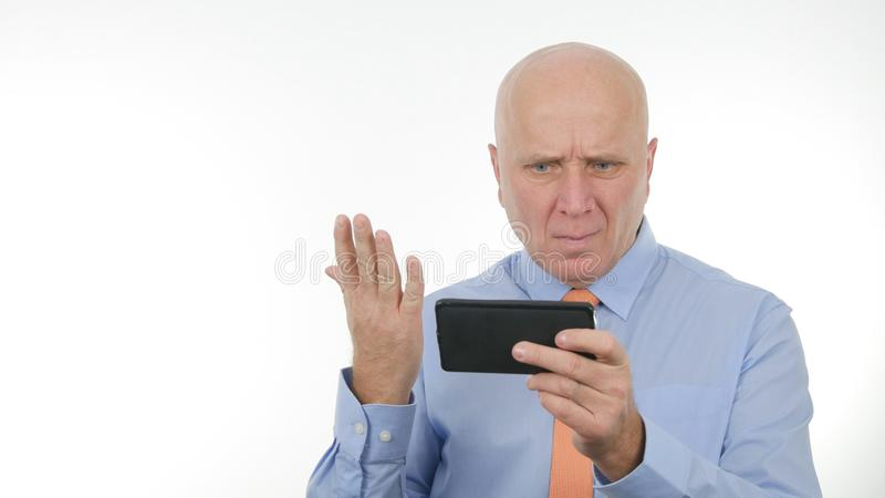 Disappointed Businessman Reading Cellphone Bad News Make Nervous Hand Gestures. Disappointed Businessperson Reading on Cellphone Bad News Make Nervous Hand stock image