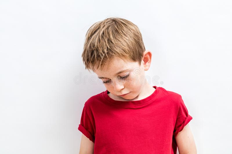 Disappointed child looking down expressing solitude, disillusion or parent problems royalty free stock images