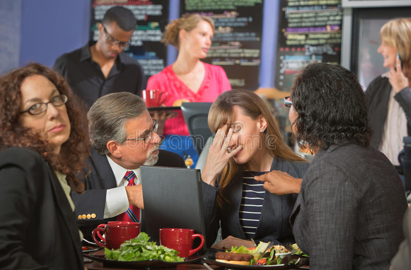 Disappointed Coworkers in Cafeteria. Disappointed white collar workers together in cafeteria royalty free stock photography