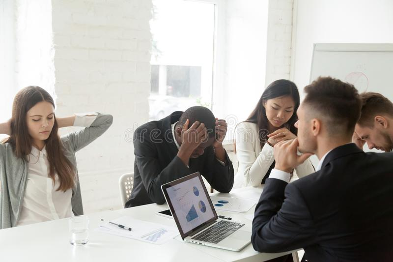 Upset colleagues feeling down because of company bankruptcy news stock photography