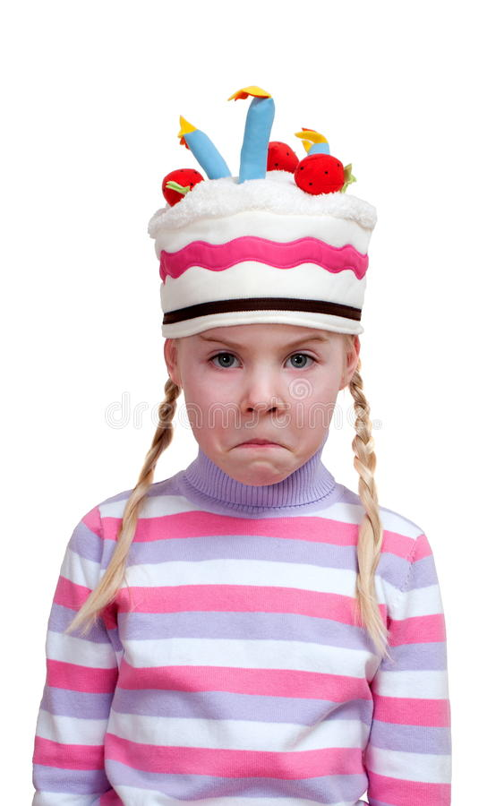 Disappointed girl in ridiculous cap royalty free stock images
