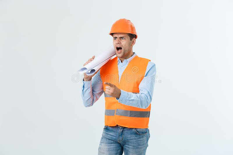 Disappointed handsome engineer wearing orange vest and jeans with helmet, isolated on white background.  stock photos