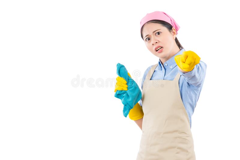 Disappointed housewife criticize your mistake. Disappointed unhappy housewife criticize your mistake by pointing with yellow gloves finger. isolated on white stock image