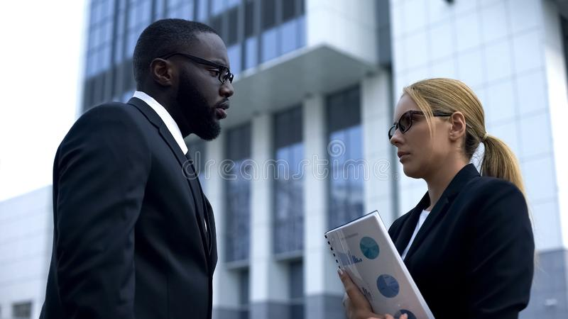 Disappointed male boss dissatisfied with employee low-skilled work, dismissal royalty free stock photography