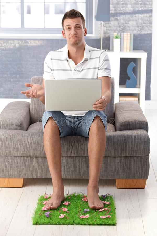 Download Disappointed man at home stock image. Image of computer - 19423413