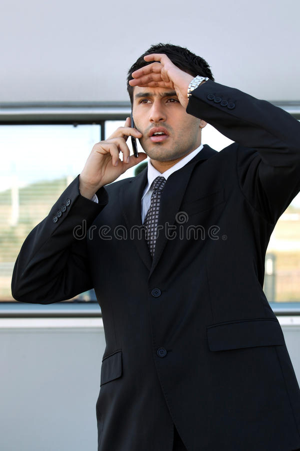Disappointed man on the phone. Disappointed man speaking on the phone stock photos