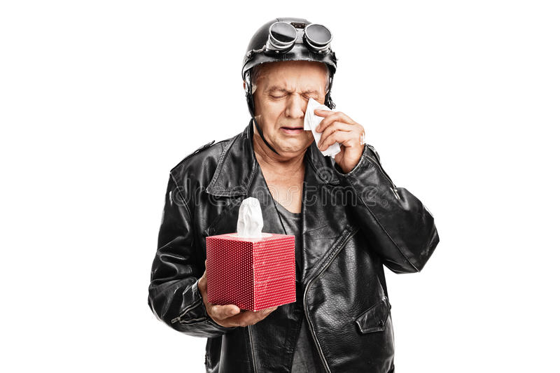 Disappointed senior biker crying royalty free stock images