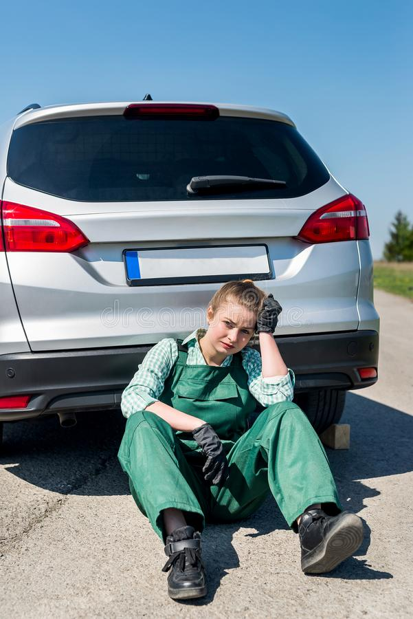 Disappointed woman with broken car on roadside.  royalty free stock image
