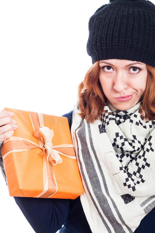 Disappointed woman with present stock photos