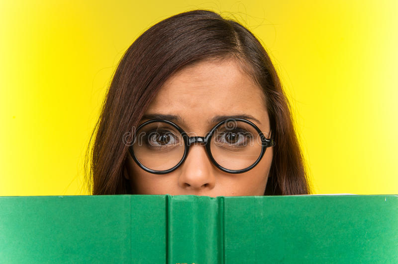 Disappointed young girl with nerd glasses. royalty free stock photos