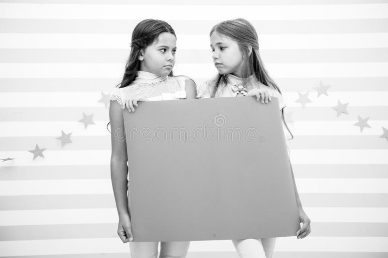 Disappointing news. Girl hold announcement banner. Girls kids holding paper banner for announcement. Children sad with. Blank paper announcement copy space royalty free stock image