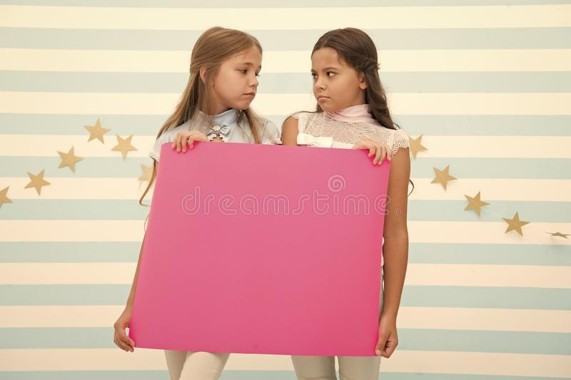 Disappointing news. Girl hold announcement banner. Girls kids holding paper banner for announcement. Children sad with. Blank paper announcement copy space royalty free stock photos
