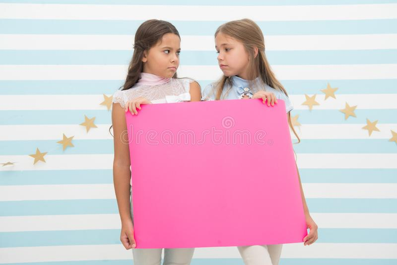 Disappointing news. Girl hold announcement banner. Girls kids holding paper banner for announcement. Children sad with. Blank paper announcement copy space royalty free stock photography