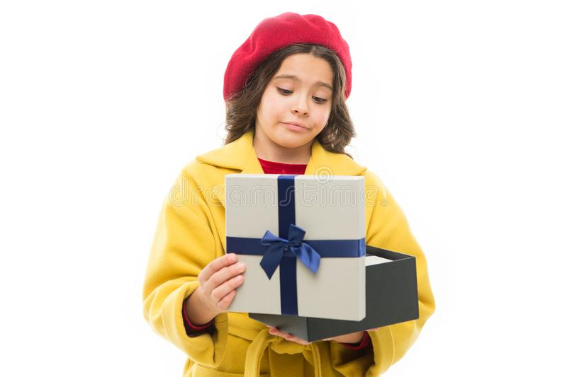 Disappointing purchase. Child stylish hold open gift box. Girl cute little lady coat and beret throws out gift. Spring. Shopping concept. Buy clothes and gifts royalty free stock photography