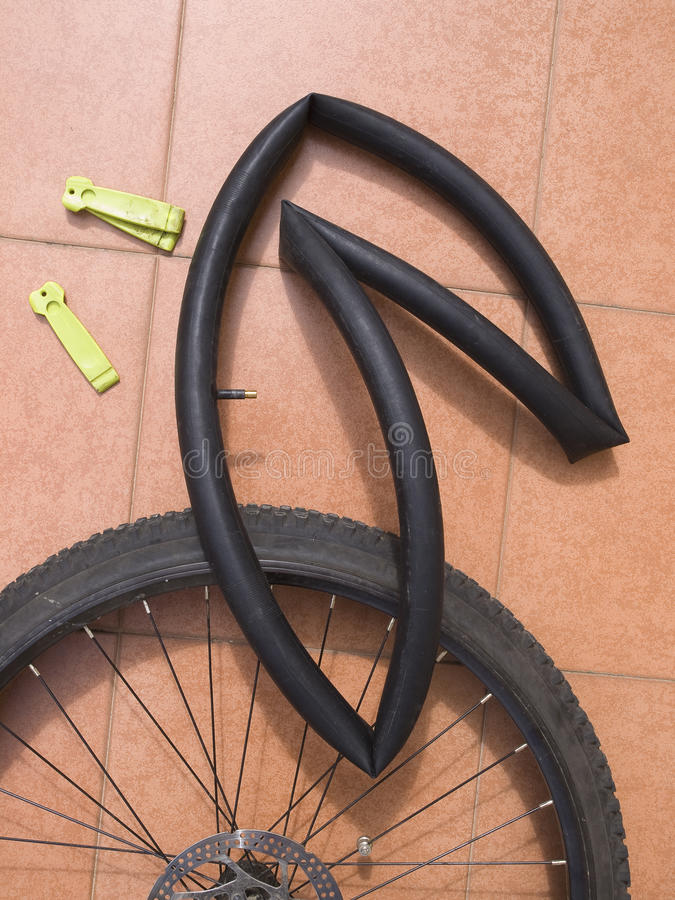 Disassembled bicycle wheel with air chamber. Disassembled bicycle wheel with tube and levers to remove the wheel royalty free stock image