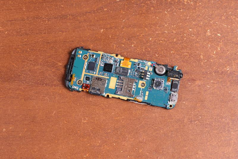 Disassembled broken cell phone repair. Disassembled broken cell mobile phone repair stock photography