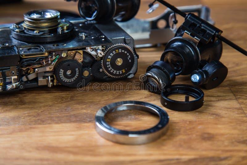 Disassembled broken film camera stock photo