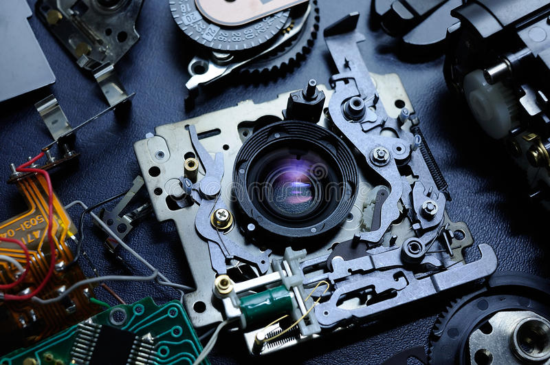 Disassembled compact camera, Flatlay. Broken and disassembled compact camera royalty free stock images
