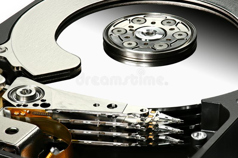 Disassembled computer hard disk drive, hdd with mirror effect. Macro photo. Opened hard drive, magnetic heads and disk plates royalty free stock photography