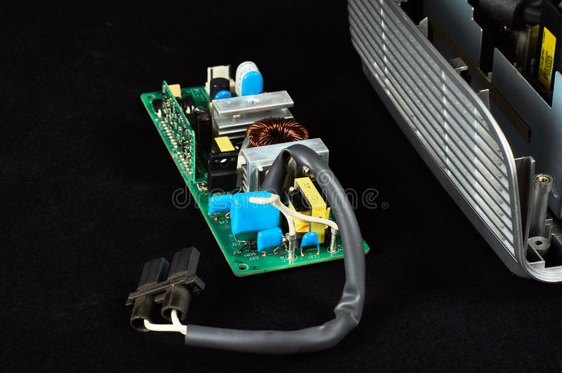 Disassembled DLP projector. Ballast of lamp DLP projector on a black velvet background stock photography