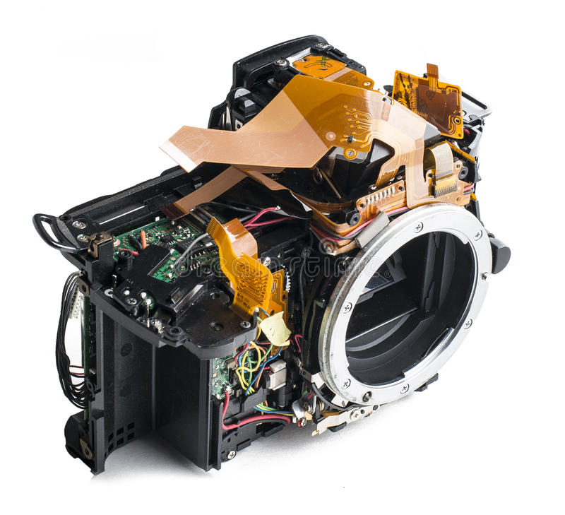 Disassembled dslr camera. On white background. Made of plastic with metal bayonet stock images