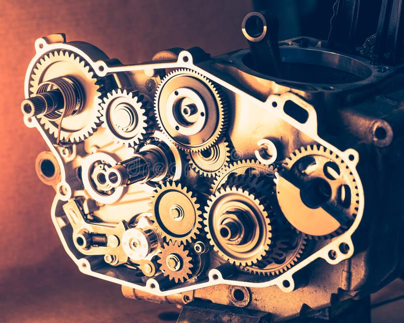 Disassembled engine of motorcycle with gear cogwheels stock photo