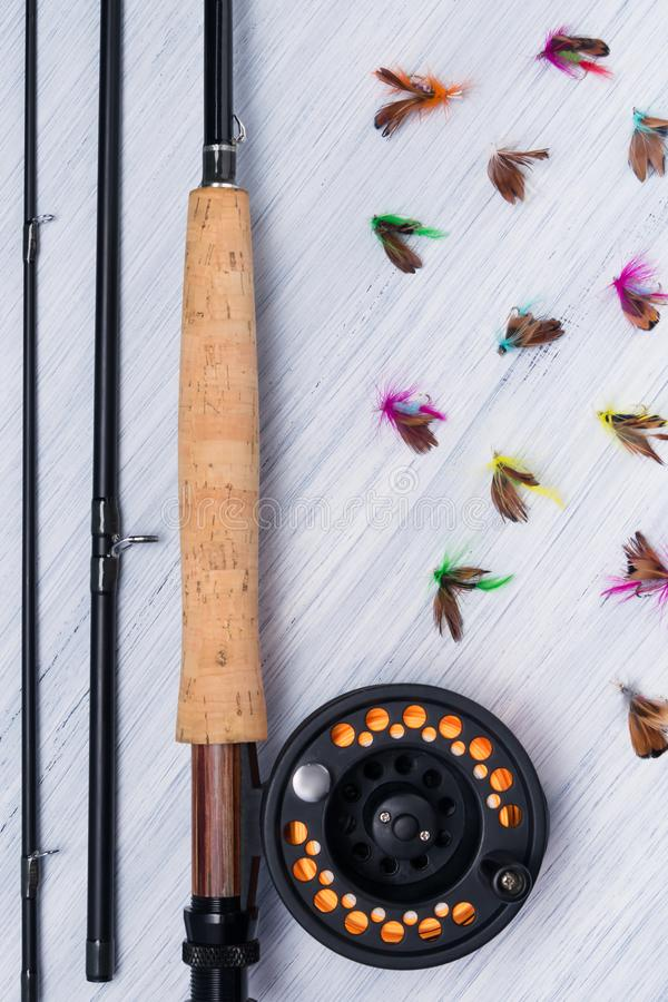 Disassembled fishing rod for fishing with bait lies on a light background of the table stock photo
