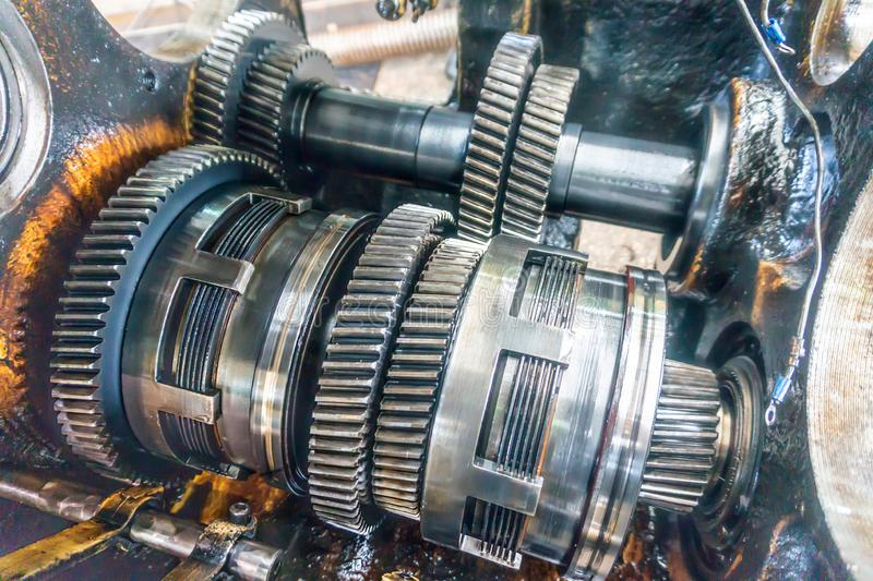 Disassembled gearbox for clutch repair and gears. Transmission for industrial machines and units disassembled stock photo