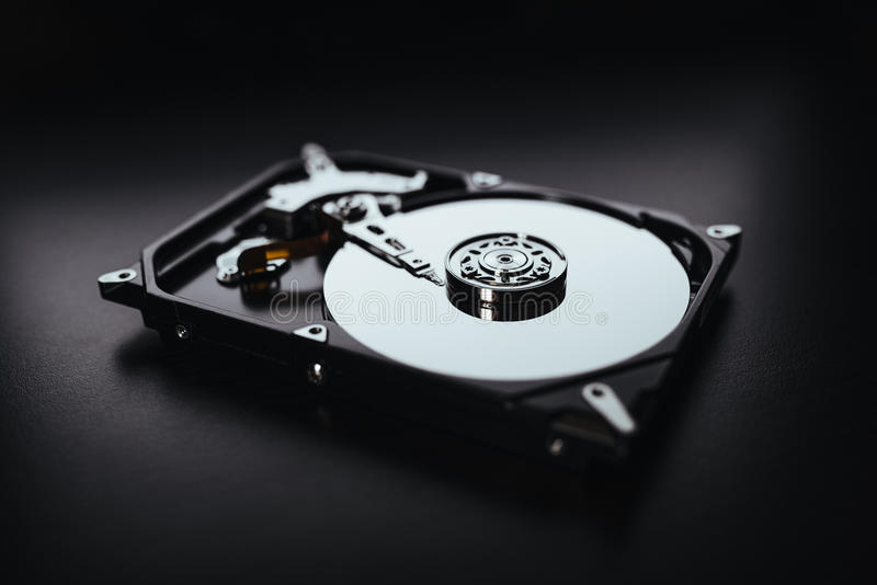 Disassembled hard drive from the computer (hdd) with mirror effects. Part of computer (pc, laptop) stock photos