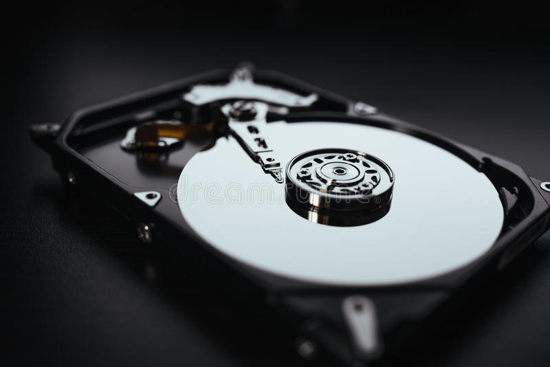 Disassembled hard drive from the computer (hdd) with mirror effects. Part of computer (pc, laptop). Opened hard drive from the computer (hdd) with mirror effects royalty free stock image