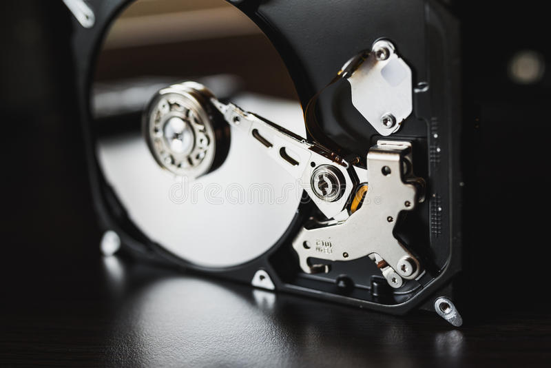 Disassembled hard drive from the computer (hdd) with mirror effects. Part of computer (pc, laptop) royalty free stock images