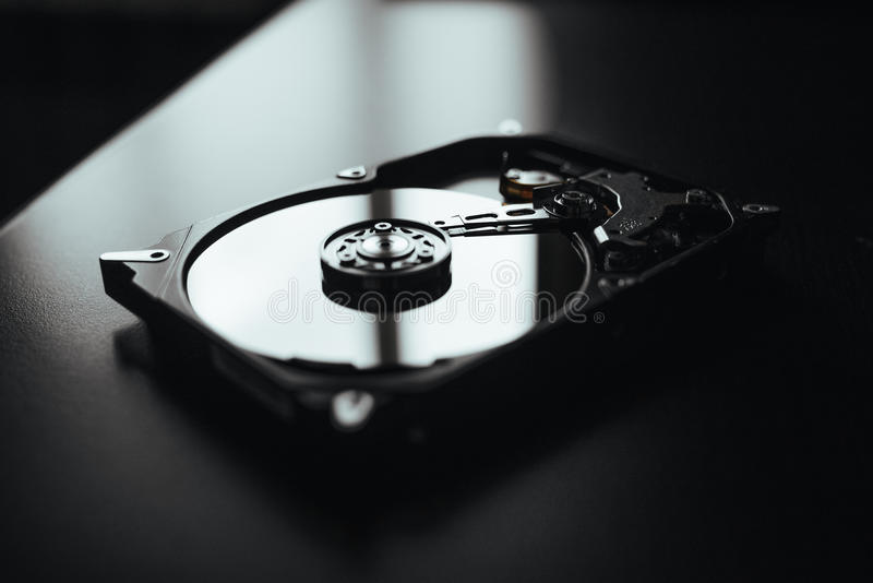 Disassembled hard drive from the computer (hdd) with mirror effects. Part of computer (pc, laptop) royalty free stock photo