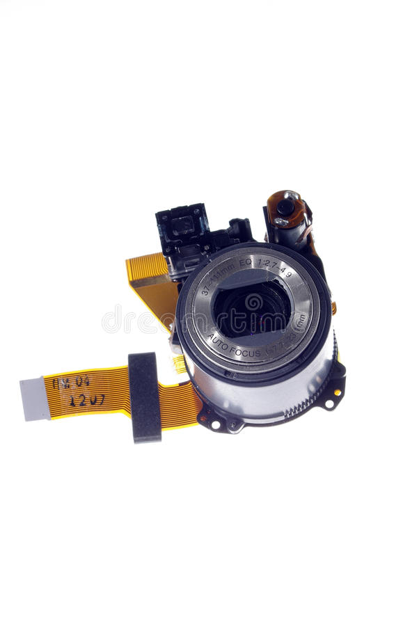 Disassembled small digital camera lens isolated 1 stock image
