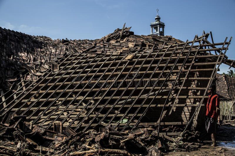 Disaster in Banten. Banten, 26 July 2016. A house destruct from heavy landslides and rock, arround 25 houses destroyed from the disaster, mosque (background) was stock photos