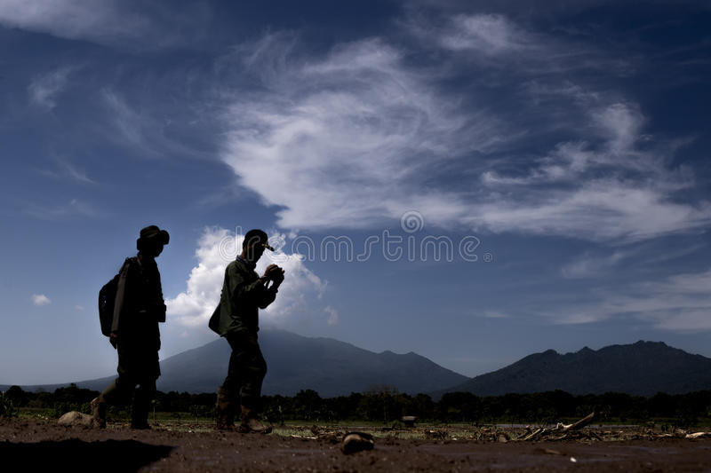 Disaster in Banten. Banten, 26 July 2016. Two officer from Forrest Department checking on the destroyed village after lanslide, their present because the village royalty free stock image