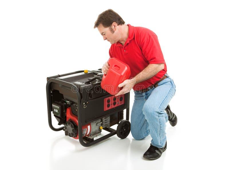 Disaster Preparedness - Filling Generator. Man puts gasoline in his 10 horsepower electric generator. Full body isolated on white stock photo