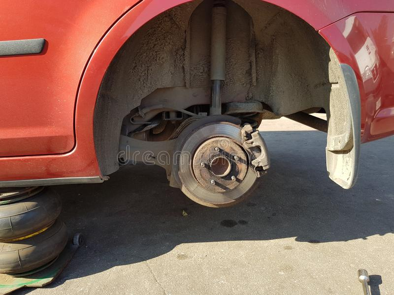 Disc brake of the vehicle for repair, in process of new tire rep royalty free stock photos