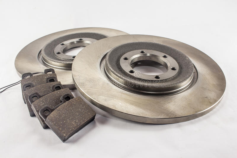Disc brakes and brake pads. Disc brakes steel with brake pads for cars royalty free stock photo