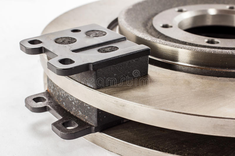 Disc brakes and brake pads. Disc brakes steel with brake pads for cars stock images