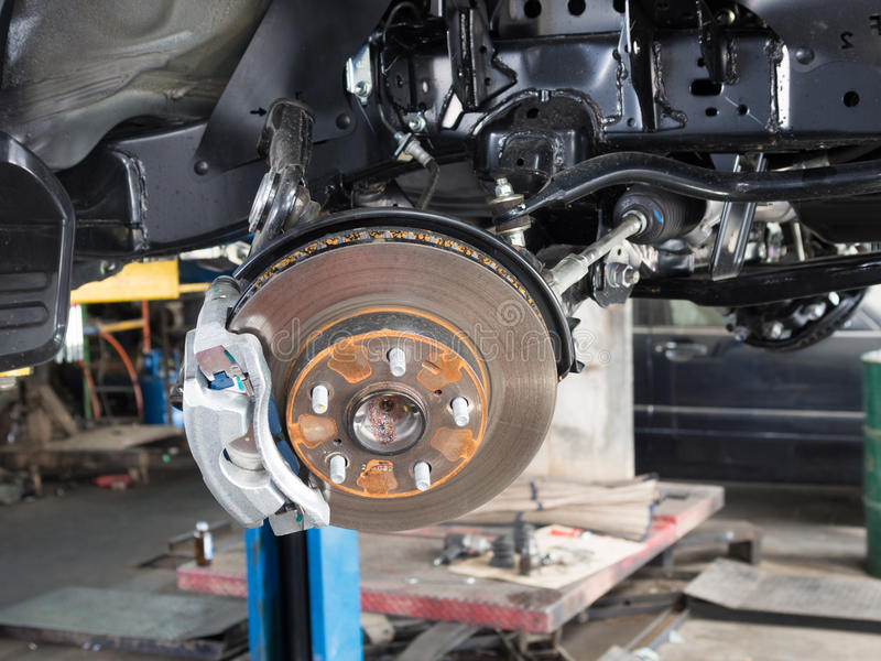 Disc break in maintenance. Wheel and disc break in maintenance process stock image